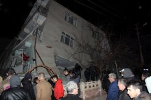 epa08160703 People waiting in front of the collapsed building after an earthquake hit Elazig, Turkey, 24 January 2020. According to reports, four people have died and several are injured after 6.7 magnitude earthquake hit Turkey, also affecting parts of Syria, Georgia and Armenia. EPA-EFE/STR