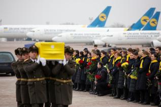 epa08140923 A handout photo made available by the Presidential Press Service of Ukraine showing relatives, friends and officials meet coffins with bodies of crew members and victims of the Ukraine International Airlines Flight PS752 at Boryspil International Airport in Kiev, Ukraine, 19 January 2020 after their bodies were returned from Iran. Iran admitted on 11 January that its armed forces had downed a Ukraine International Airlines passenger jet with 176 civilians on board and said it had been an involuntary human error. EPA-EFE/HANDOUT HANDOUT EDITORIAL USE ONLY/NO SALES