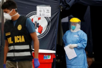 Peru, Panama limit men and women to alternate days out to stall virus