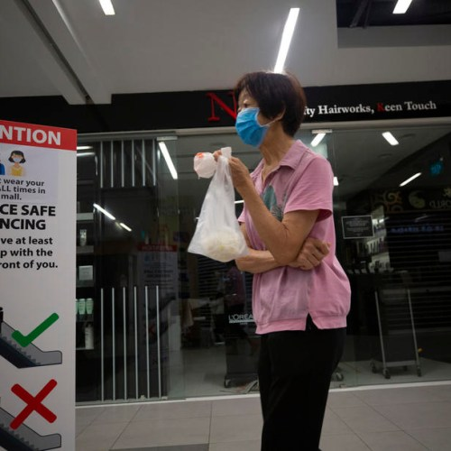 Photo story: Singapore imposes entry limits to supermarkets