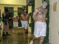 epa08385619 A handout photo made available by the El Salvador Presidency shows inmates during an inspection at the Maximum Security Jail in Zacatecoluca, El Salvador, 25 April 2020 (issued 26 April 2020). Salvadorean President Nayib Bukele ordered jails to impose solitary confinement of gang leader inmates, following a wave of homicides in the country. Investigations have uncovered that part of the homicides were ordered from gang leaders in jails. EPA-EFE/El Salvador Presidency / HANDOUT HANDOUT EDITORIAL USE ONLY/NO SALES