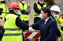 epa08388621 Italian Prime Minister Giuseppe Conte (R) greets Liguria Region President Giovanni Toti (L) wearing a protective face mask as he arrives for the inauguration ceremony of the last part of the deck of the new Genoa motorway bridge in Genoa, Italy, 28 April 2020. The new Genoa bridge, designed by architect Renzo Piano, will be inaugurated 28 April in the presence of Prime Minister Conte. The new bridge is under construction after the Morandi highway bridge partially collapsed on 14 August 2018, killing a total of 43 people. EPA-EFE/Luca Zennaro