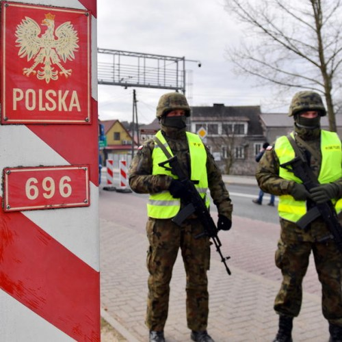 Poland says Belarus lets migrants cross border in 'hybrid war' with EU