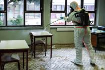 epa08391960 Personnel of the Military Police equipped with protective suits take part in a demonstration of a disinfection action at the Amadora Secondary School, in Amadora, Portugal, 29 April 2020. The action was carried out by elements of the Military Police as a measure to stem the widespread of the SARS-CoV-2 coronavirus that causes the COVID-19 disease. Schools all over the country are part of the operation, which involves more than 400 military personnel of the three branches of the Armed Forces. EPA-EFE/MIGUEL A. LOPES