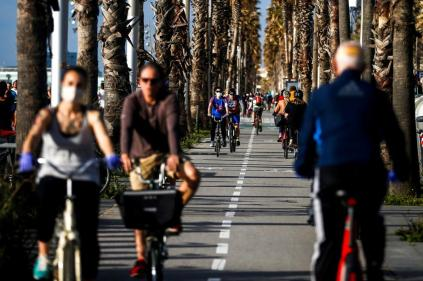 epa08397025 Several people do exercise Paseo Maritimo promenade in the early morning in Barcelona, Spain, 02 May 2020. Spain begins a de-escalation phase amid coronavirus outbreak allowing adults go out home daily with restrictions. Adults are allowed to do exercise and go out for a walk from 6 to 10 am and 8 to 11 pm. Elderly people can go out for a walk from 10 am to 12 pm and 7 pm to 8 pm and under-14 children from 12 pm to 7 pm. Spain is under a lockdown to avoid the spreading of pandemic of the COVID-19 disease caused by the SARS-CoV-2 coronavirus. EPA-EFE/Quique Garcia