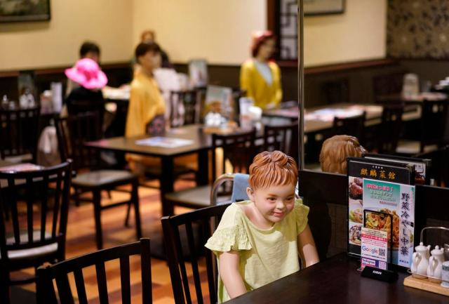 Mannequins used to keep social distancing at a restaurant