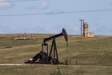 Oil slips but heads for steady week on supply tightness