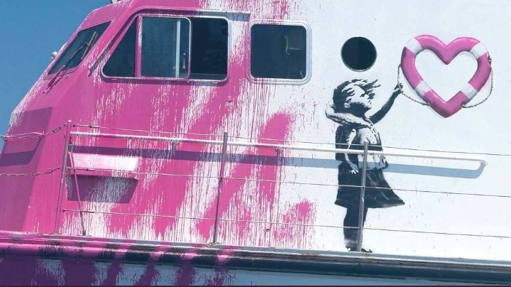 Italian coastguard rescues people on board rescue ship funded by Bansky