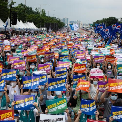 South Korean doctors strike over health plans as new coronavirus cases climb