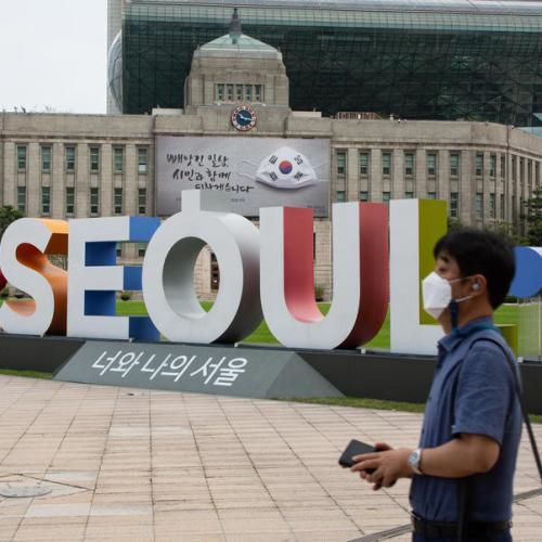 South Korea tightens restrictions, mandates wearing of masks