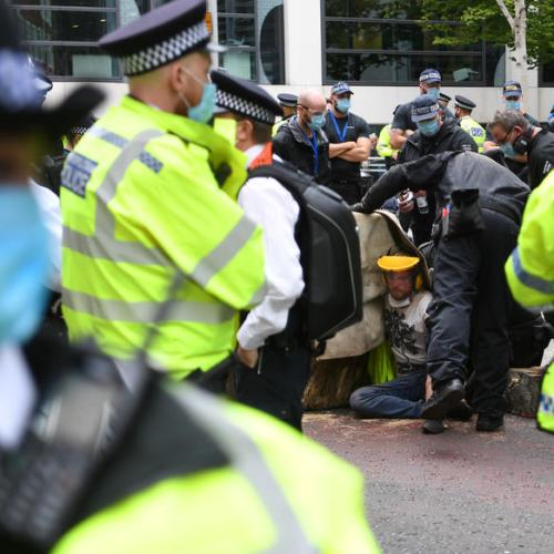 Climate activists glue themselves to street outside British parliament