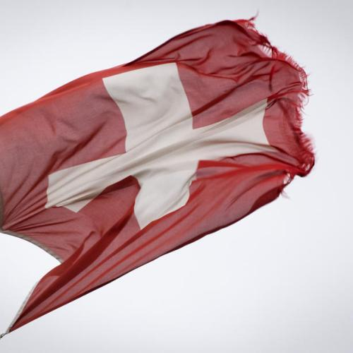 Swiss National Bank turns less gloomy, keeps policy on hold
