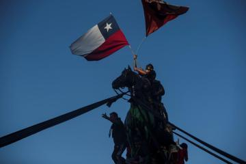 Chileans vote by millions to tear up Pinochet's constitution