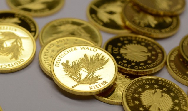 Gold firms as dollar dips, coronavirus concerns grow