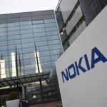Nokia cuts full-year profit forecast, sets new strategy