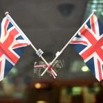 UK factories grow for fourth month, job losses slow