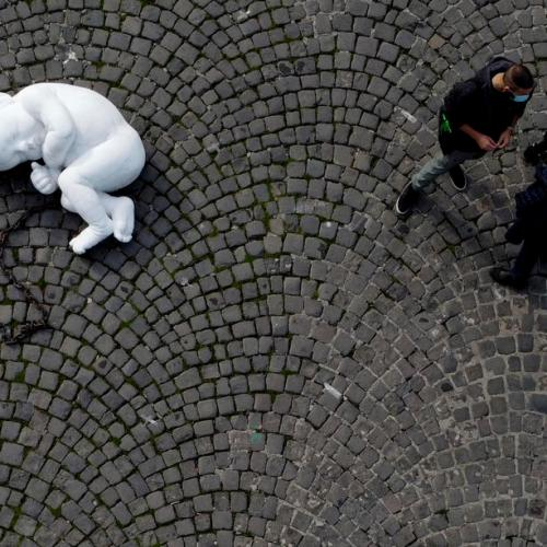 Photo Story: Sculpture in Naples square to urge people to reflect on coronavirus consequences