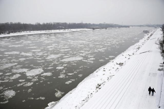 Photo Story: Frozen Vistula river in Warsaw, cold snap drives power demand to record high