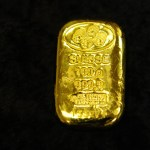 Gold scales 2-week high as dollar slips