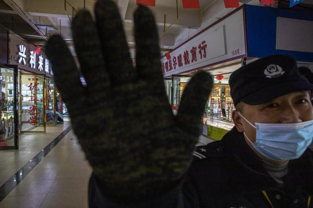 China plays down WHO concern about delay in coronavirus team's trip