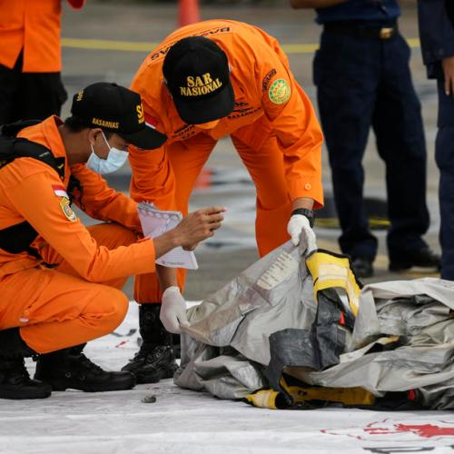 Indonesia finds body parts, debris, detects emergency signal of crashed jet