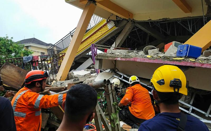 Indonesia's president promises to rebuild city hit by earthquake as death toll reaches 90