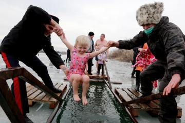 Photo Story: Orthodox Christians take Epiphany ice baths in Kyrgyzstan