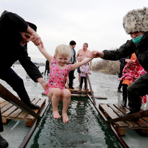 Photo Story: Orthodox Christians take Epiphany ice baths in Kyrgyzstan