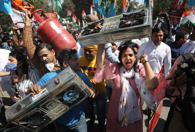 Photo Story: Indian Youth Congress (IYC) activists protest against fuel price hike in New Delhi