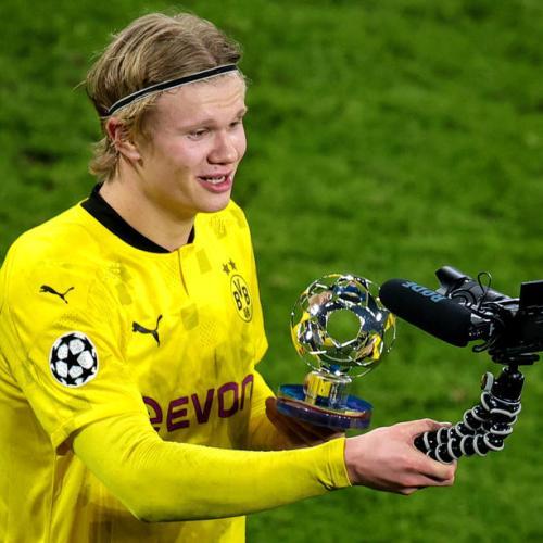 Haaland goals send Dortmund past Sevilla into last eight