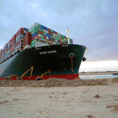 In Pictures – Tugs, dredgers still struggle to free ship blocking Suez Canal