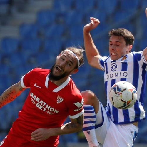 Sevilla stay in title race with comeback win at Sociedad