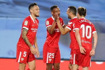 Title-chasing Real snatch draw with Sevilla after VAR drama