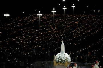 Thousands pray at Portugal's Fatima shrine for world without COVID-19