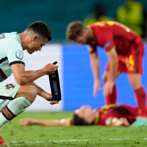 Hazard rocket fires Belgium past holders Portugal into last eight