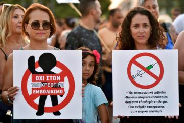 Thousands protest new Greek Covid-19 rules, pressure to get jabs