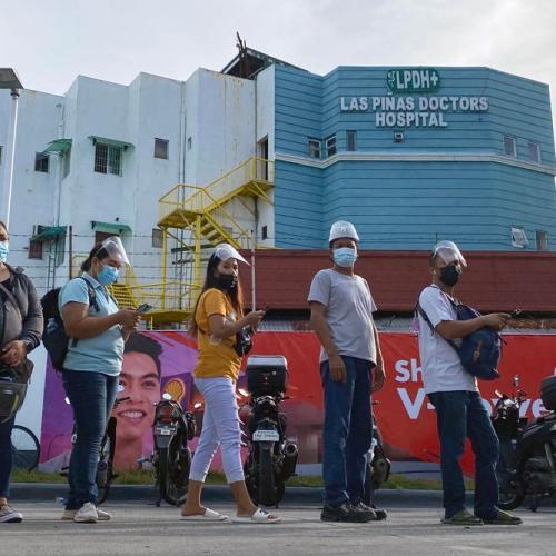 Hundreds of Philippine hospitals near full capacity as virus cases surge