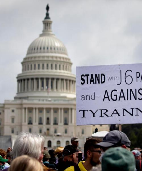 Amid high security, small pro-Trump crowd rallies at U.S. Capitol