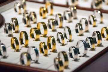 Gold hits over 1-month low as stronger dollar dents appeal
