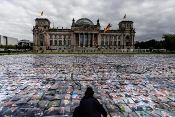 Photo Story – Human rights group protest in front of the Reichstag building