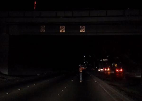 Video: Guy Jumps Off Overpass, Lands Hard and Walks Away