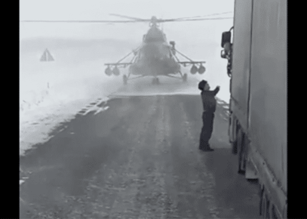 Helicopter Pilot Stops To Ask Trucker For Directions