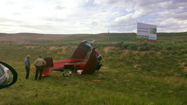 A bi-plane pilot survived a terrifying ordeal during which he collided with a semi truck while trying an emergency landing on I-80 yesterday, according to the Wyoming Highway Patrol.