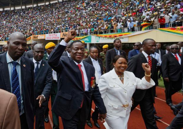 Emmerson Mnangagwa, center, and his wife Auxillia, center-right, arrive at the presidential inauguration ceremony in the capital Harare, Zimbabwe (AP Photo/Ben Curtis)