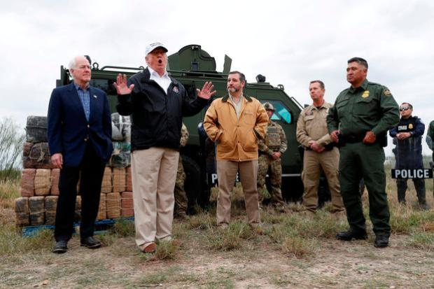President Donald Trump speaks to reporters as he visits the banks of the Rio Grande River with Senator John Cornyn, Senator Ted Cruz and US Customs and Border Patrol agents in Mission, Texas, January 10, 2019. REUTERS/Leah Millis