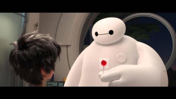 Just what the doctor ordered: Baymax, an inflatable healthcare companion with a big 'heart', gives his young charge, Hiro, a lollipop in the children's animated movie, Big Hero Six