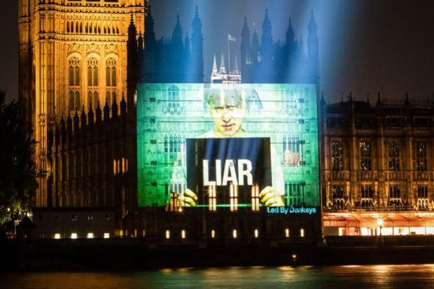 Lit up: Led By Donkeys group photo of its projection on Houses of Parliament of Boris Johnson with a board saying 'Liar'. Photo: POW/Led By Donkeys/PA Wire