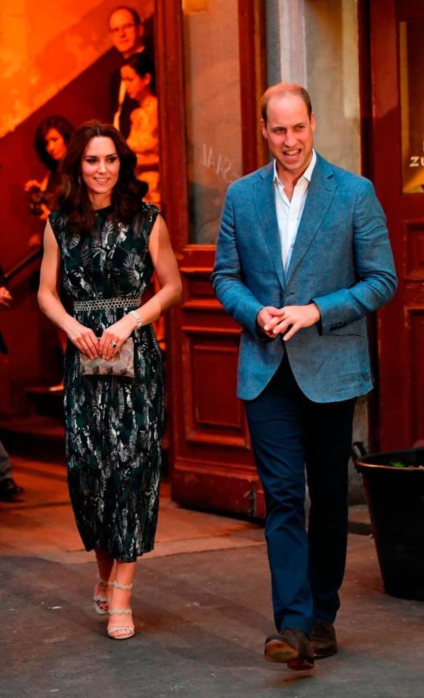 Britain's Princess Kate, the Duchess of Cambridge, and Britain's Prince William, Duke of Cambridge attend a reception at 'Claerchens Ballhaus' dance hall in Berlin, on the second day of the British royal couple visit to Germany, on July 20, 2017 in Berlin. / AFP PHOTO / dpa / Jens Kalaene / Germany OUTJENS KALAENE/AFP/Getty Images