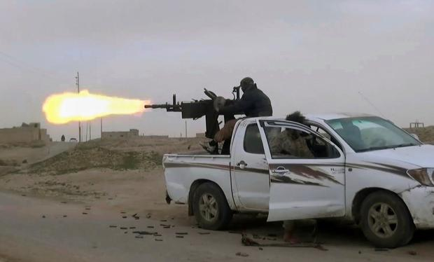 This frame grab from video posted online Friday, Jan. 18, 2019, by supporters of the Islamic State group, purports to show a gun-mounted Islamic State group vehicle firing at members of the U.S.-backed Syrian Democratic Forces, in the eastern Syrian province of Deir el-Zour, Syria. s they cling to the tiny remains of what was once a self-styled caliphate spanning two countries, IS militants are laying the groundwork for an insurgency. (Militant Photo via AP)