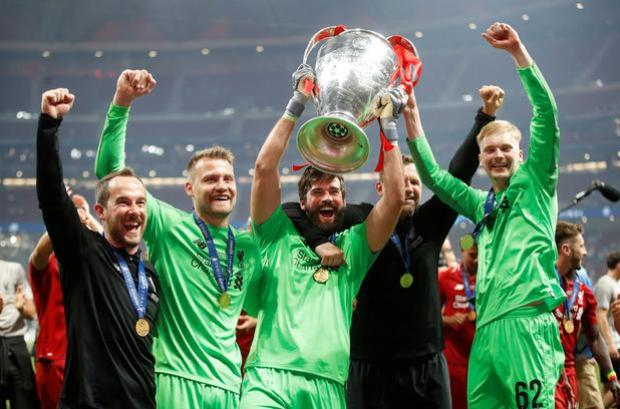 Caoimhin Kelleher (right) celebrating Liverpool's Champions League win with team-mates Simon Mignolet and Alisson in June. Photo: Getty